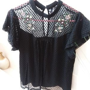 Lace blouse with embroidery